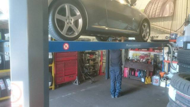 Car on lift for exhaust replacement